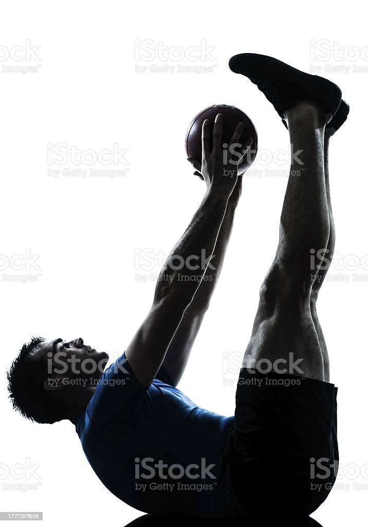 man exercising workout holding fitness ball posture stock photo