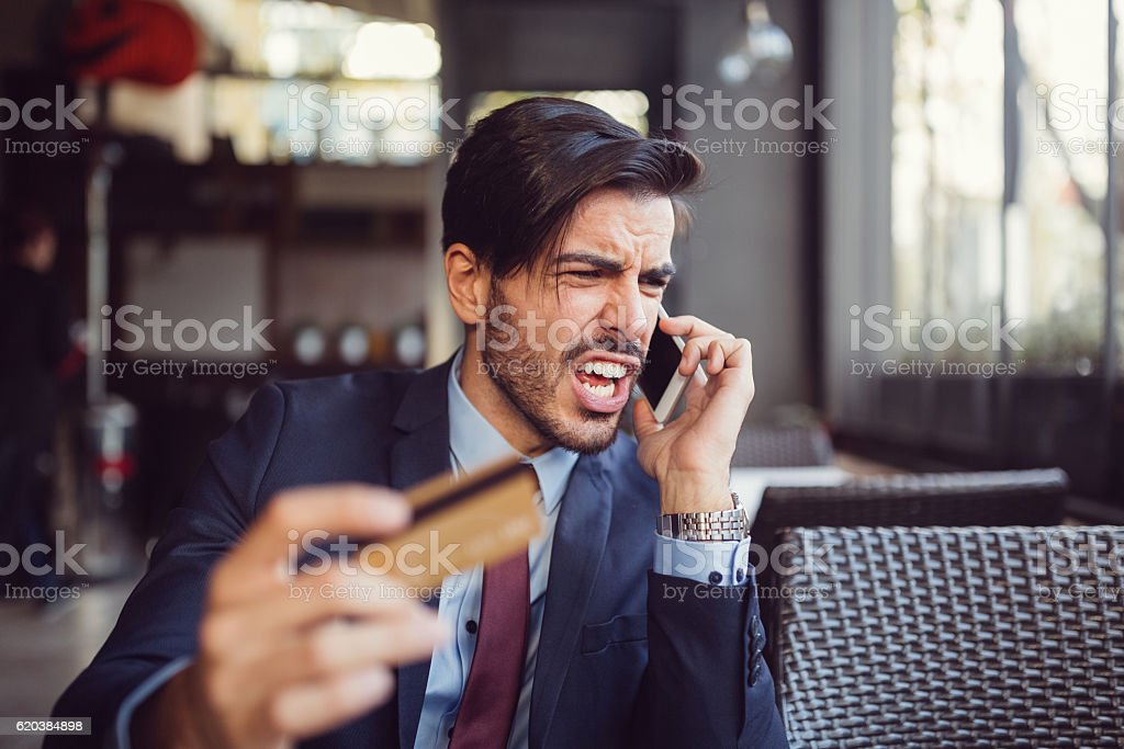 Man experiencing problems with his credit card stock photo