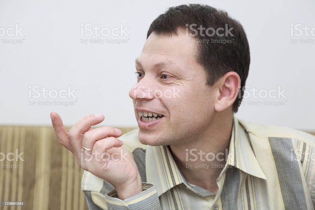 Man explains something royalty-free stock photo