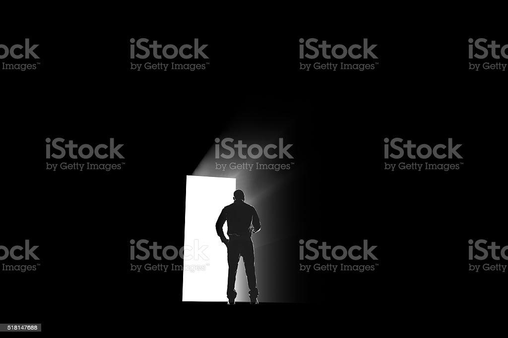 man exploring a portal light stock photo