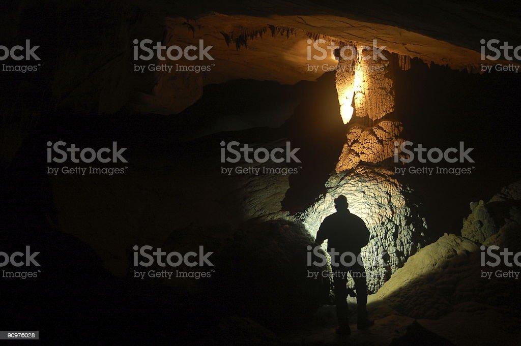 Man exploring cave stock photo