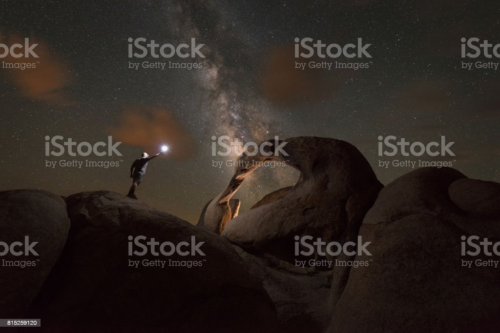 Man exploring Mobius Arch at night stock photo