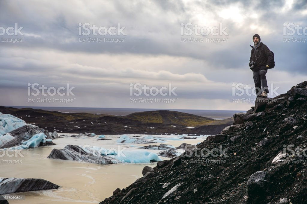 Man exploring the wild area and remote places in Iceland stock photo