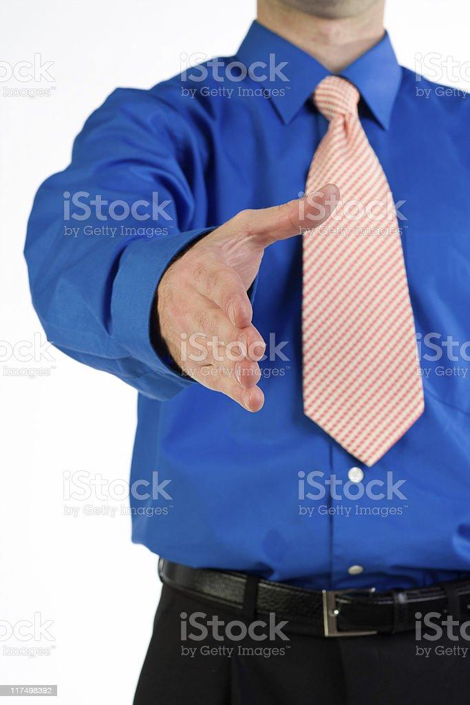Man extending handshake royalty-free stock photo