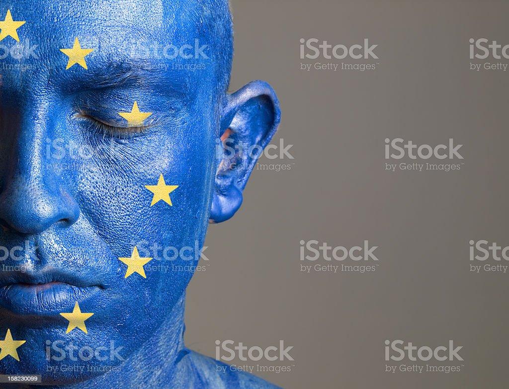 Man face flag European Union, closed eyes royalty-free stock photo