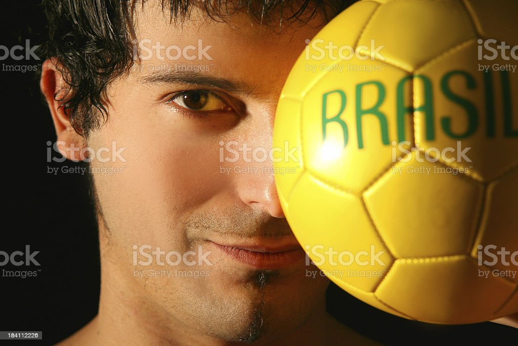 Man Face with Brazil Soccer Ball royalty-free stock photo