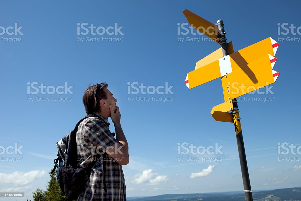 Man facing a difficult choice royalty-free stock photo