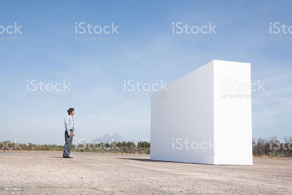 Man facing wall outdoors stock photo