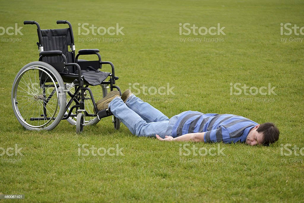 Man Fallen From Wheelchair royalty-free stock photo