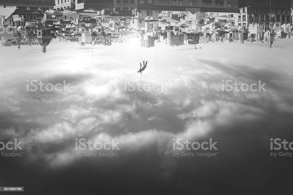 man falling from upside down city stock photo