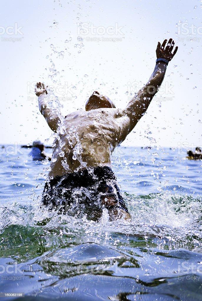 man falling in sea splashing water royalty-free stock photo