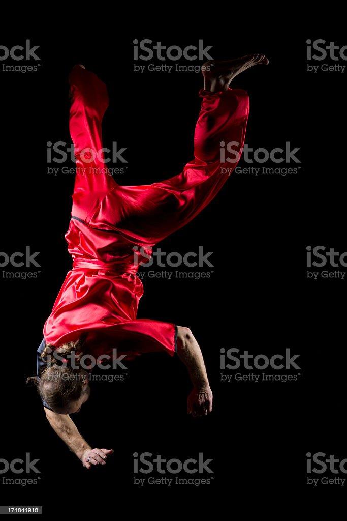 Man falling upside down in midair stock photo