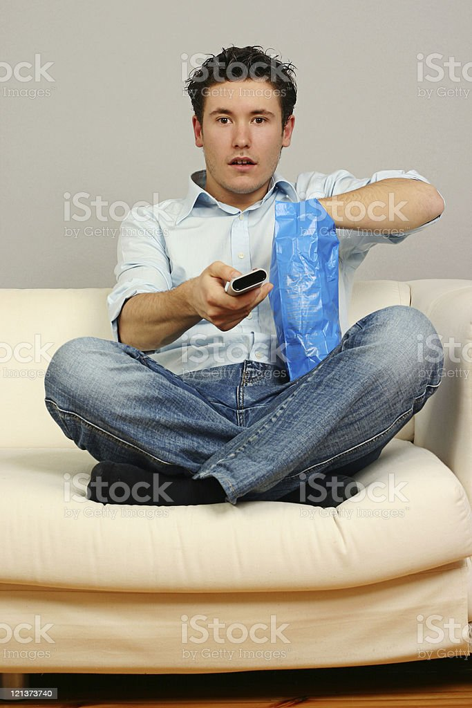 Man fascinated by TV royalty-free stock photo