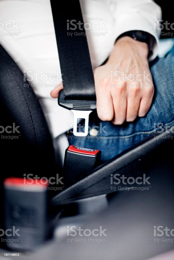 Man fastening seat belt stock photo