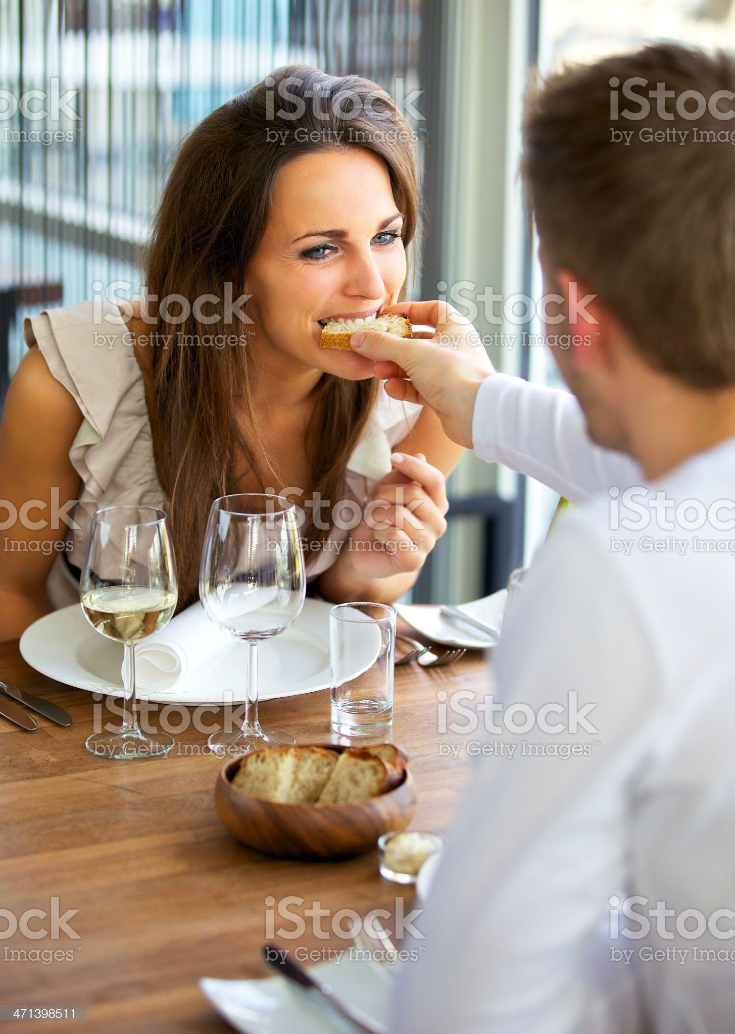 Man Feeding Bread to His Girlfriend royalty-free stock photo