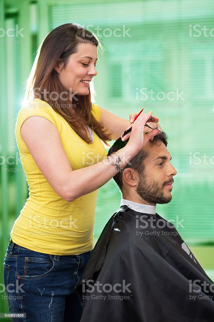 man feel relaxes when stylist is cuting his hair stock photo