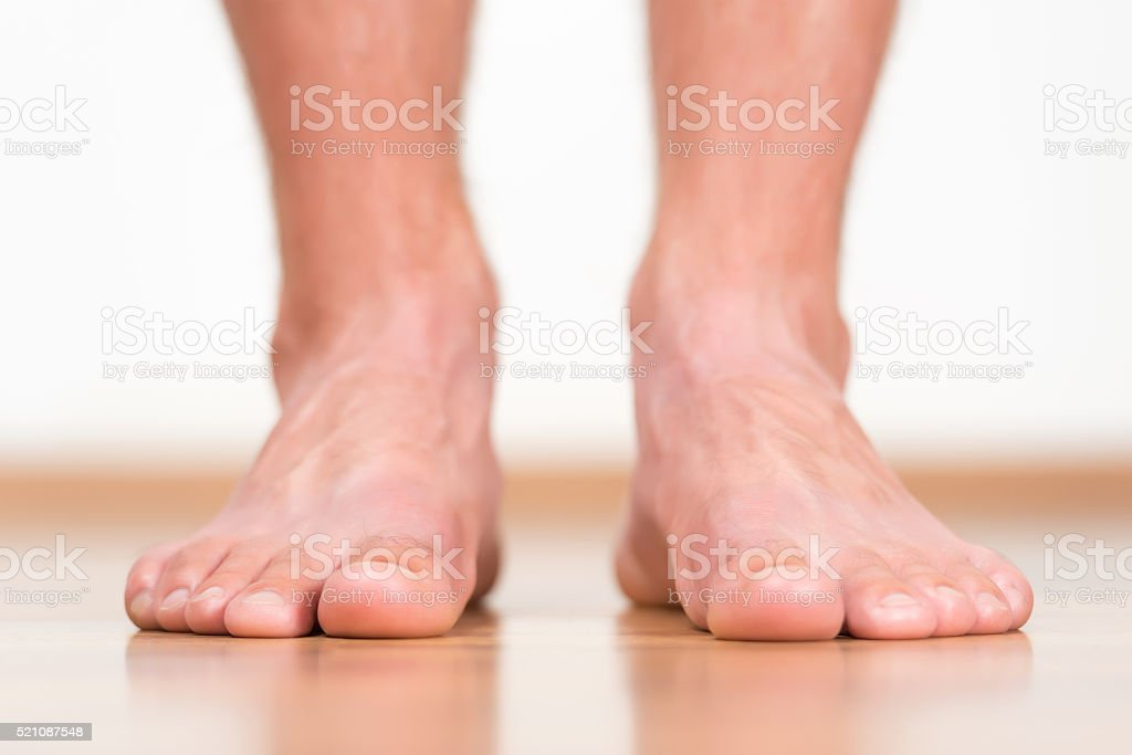 Man feet stepping on the flor stock photo