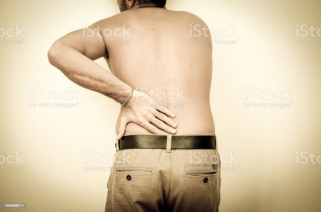 Man felt severe pain on the body stock photo