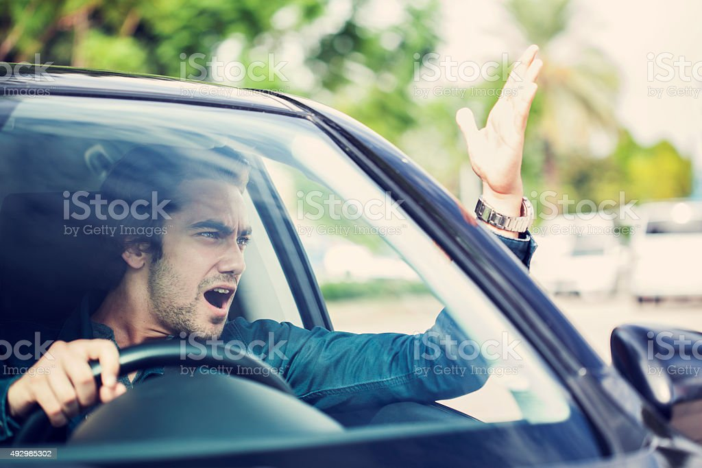 Man fight in traffic stock photo