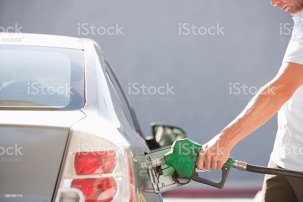 Man filling car with gas stock photo