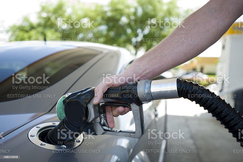 Man filling gas pump stock photo