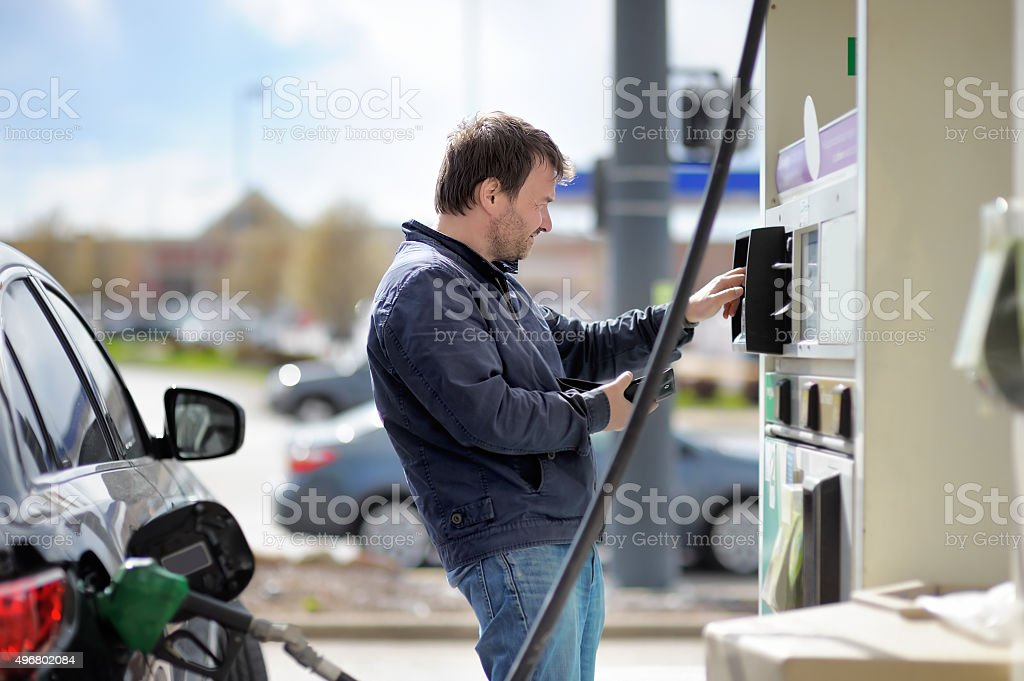 Man filling gasoline fuel stock photo