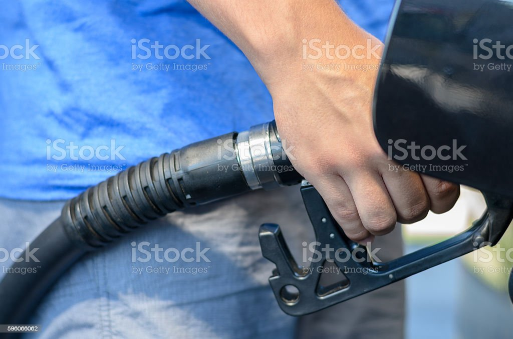 Man filling his car with gasoline stock photo
