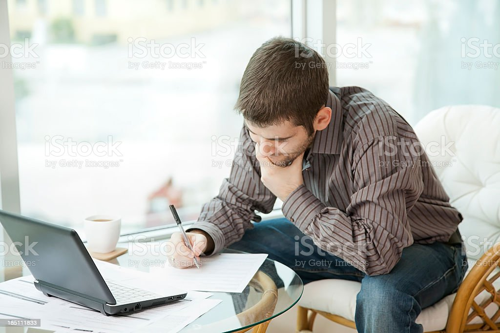 Man filling out a form stock photo