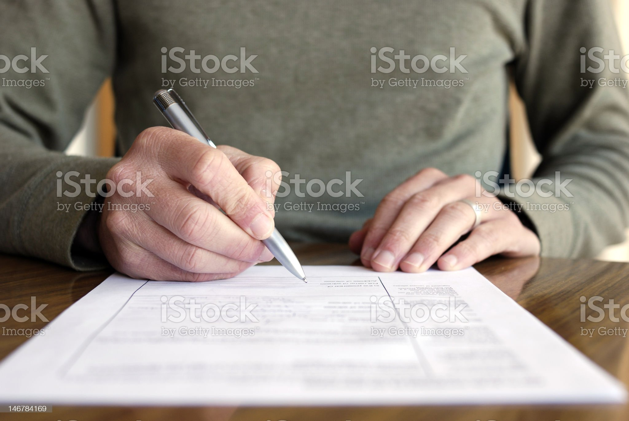 Man Filling Out Form on Table royalty-free stock photo
