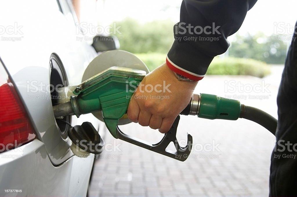 Man filling up the car pump focus stock photo