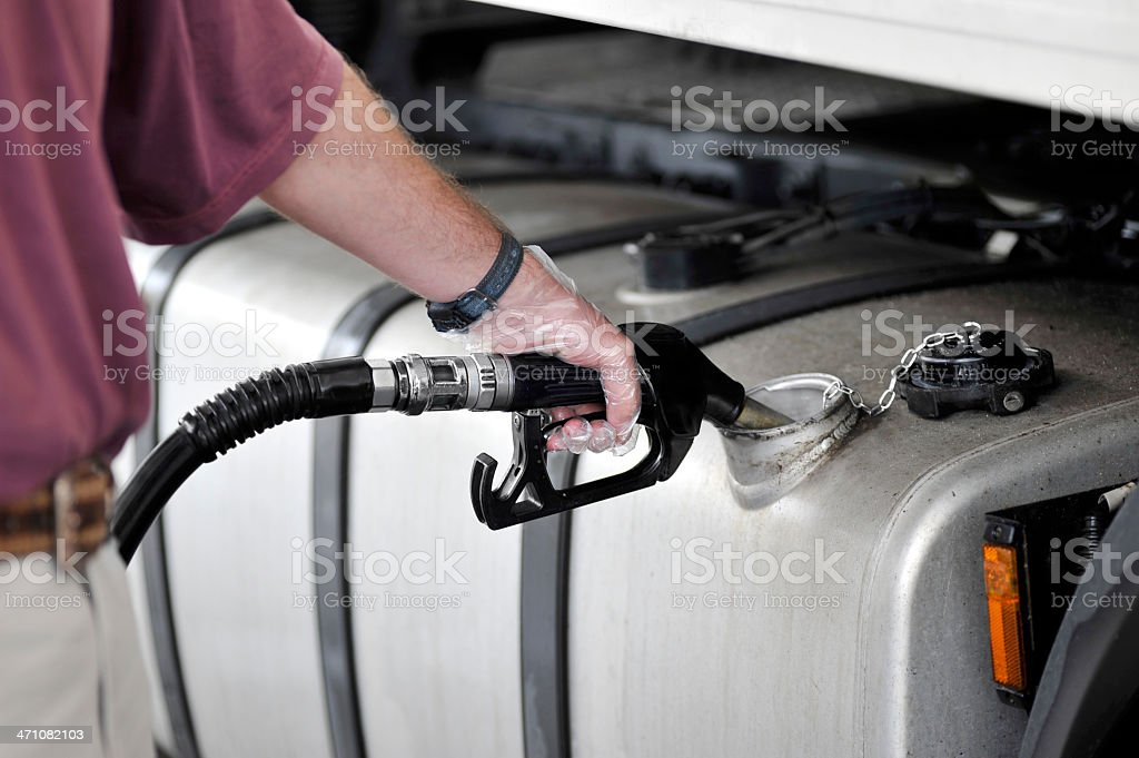 Man filling up the gas tank with gasoline stock photo