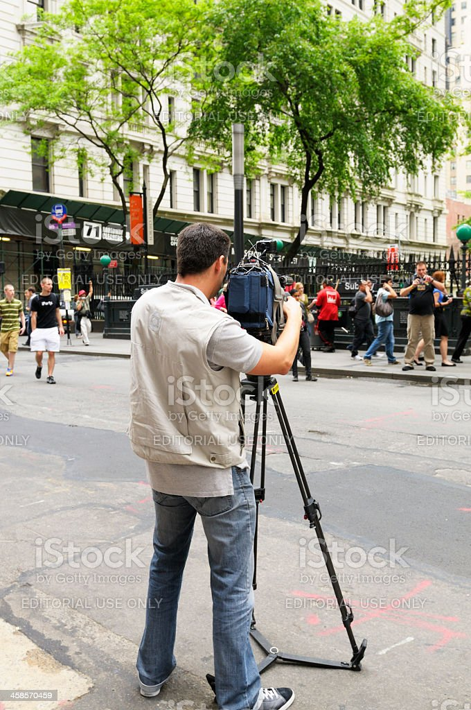 Man filming people, NYC. royalty-free stock photo