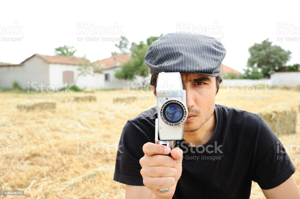Man filming with 16mm camera royalty-free stock photo