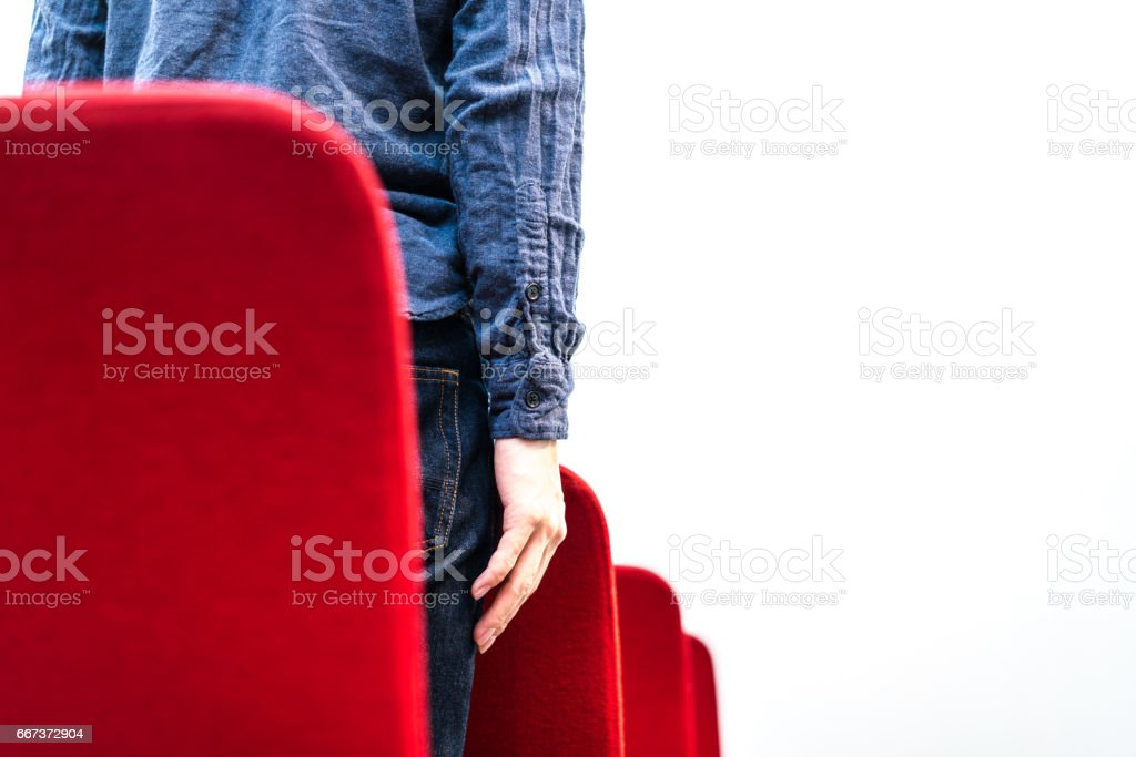 Man finding a chair stock photo