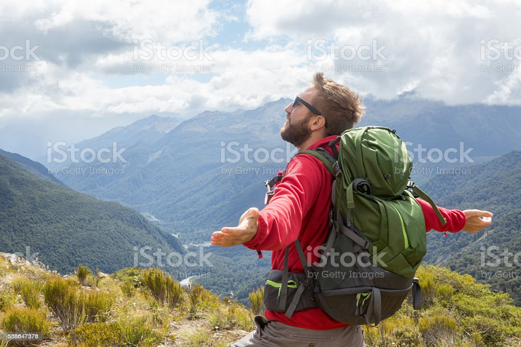 Man finds freedom and success in nature stock photo