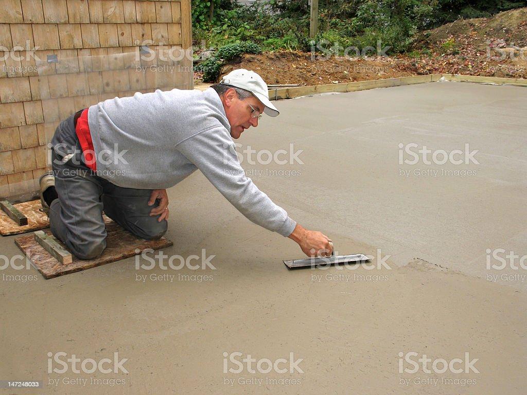 Man finishing concrete slab stock photo