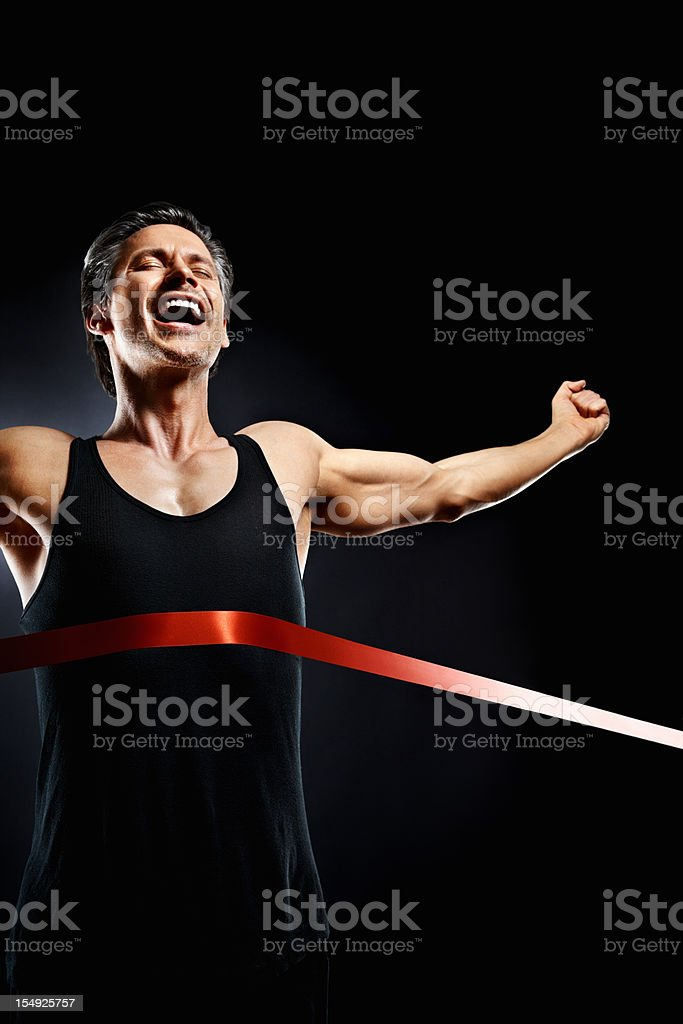 Man finishing first place in race royalty-free stock photo