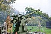 Man firing anti aircraft gun in re-enactment