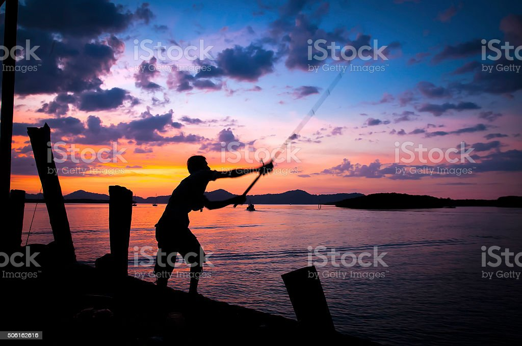 Man fishing , a marina , Thailan stock photo