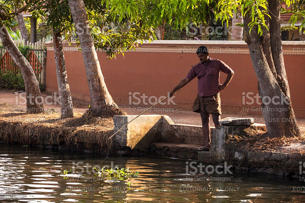 Man fishing along the Kerala Backwaters in India stock photo