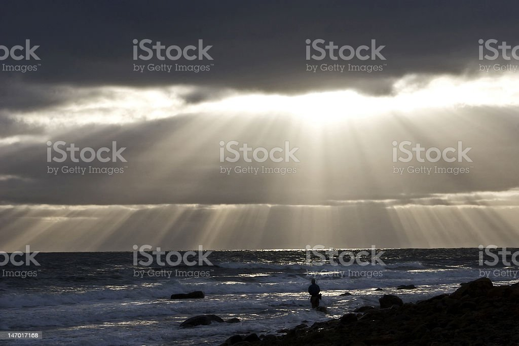 Man Fishing and Sunrays royalty-free stock photo