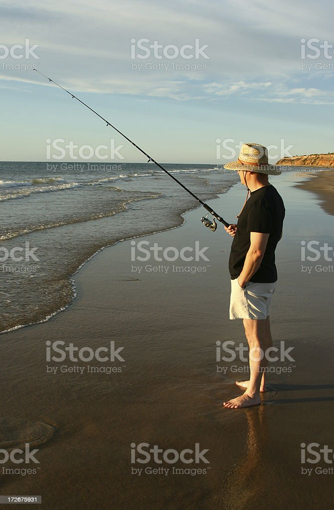 Man fishing at beach 3 royalty-free stock photo