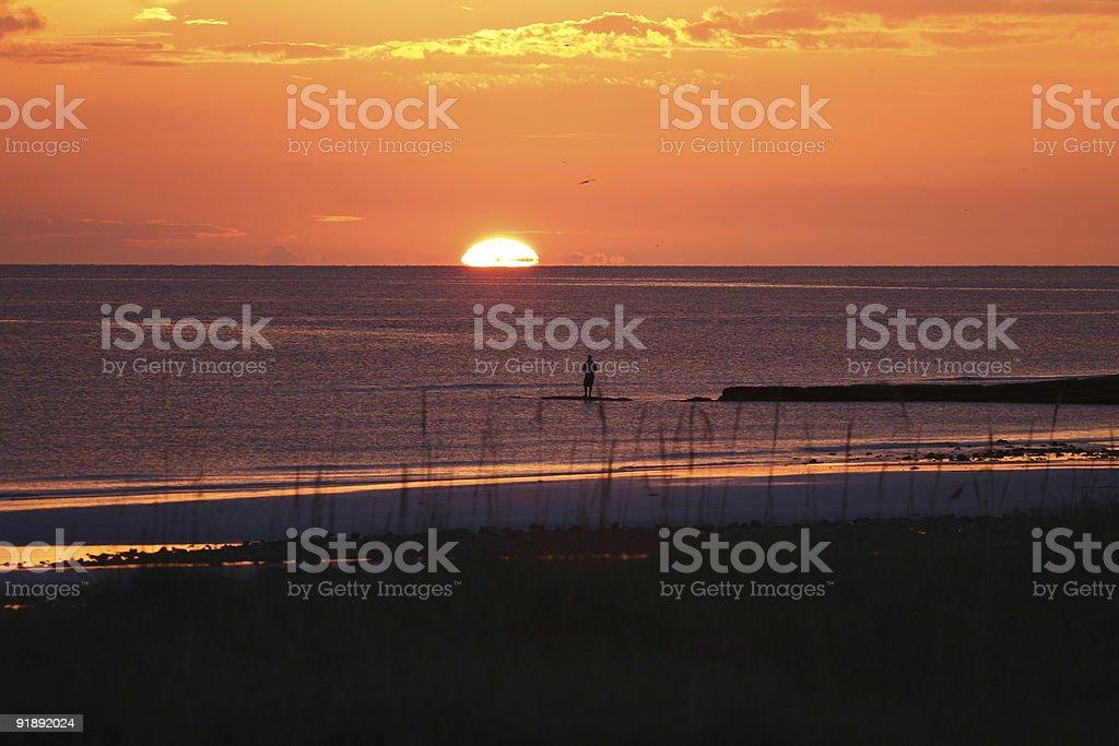 Man Fishing at Sunset royalty-free stock photo