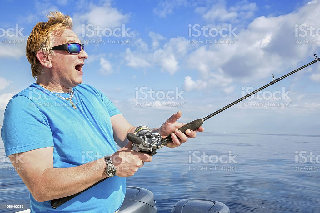 Man fishing Hooked a big fish royalty-free stock photo