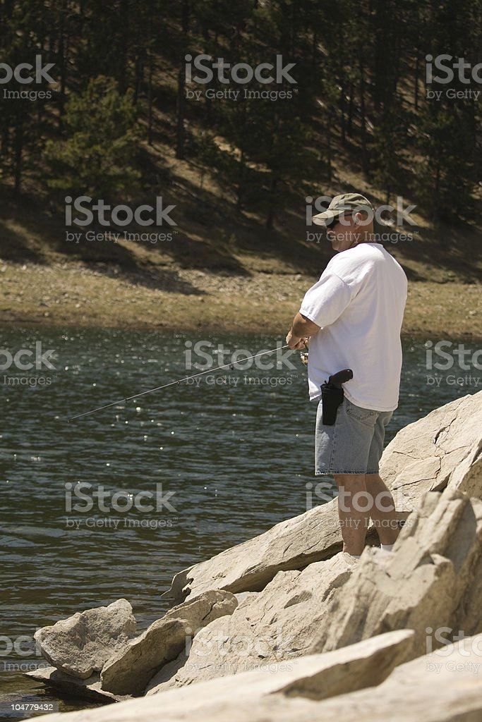Man Fishing in Mountain Lion Country stock photo