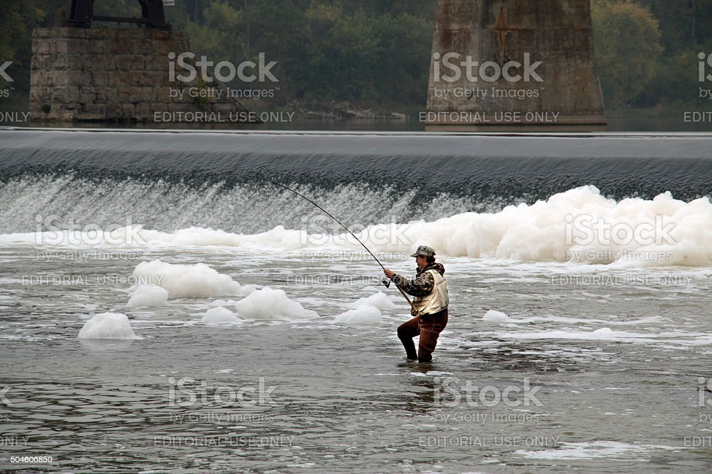 man fishing in river stock photo