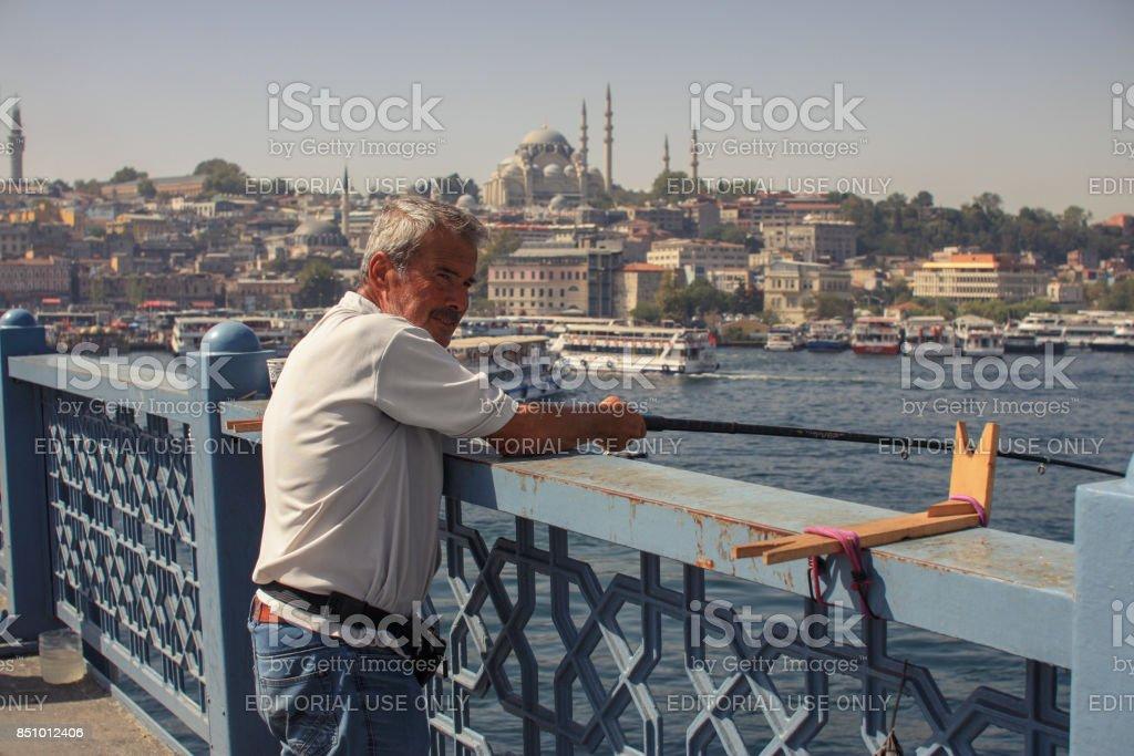 Man Fishing on Galata Bridge stock photo