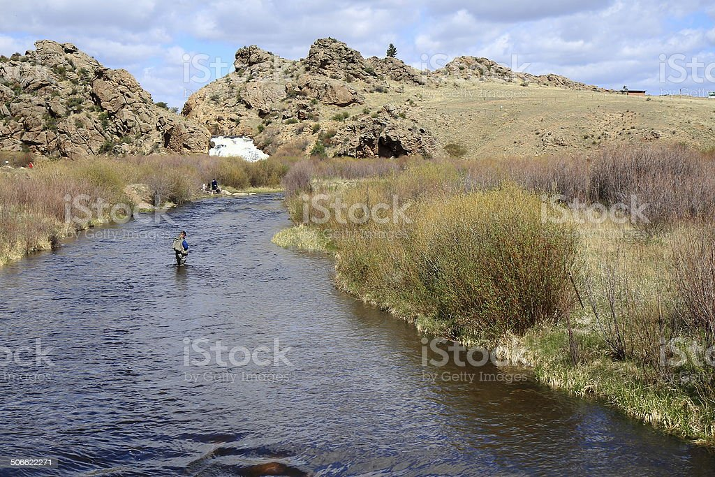 Man fishing on Tarryall Creek, South Park, Colorado stock photo