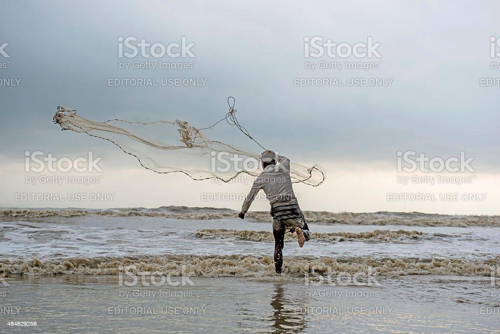 Man fishing on the beach of Cox's Bazar, Bangladesh stock photo