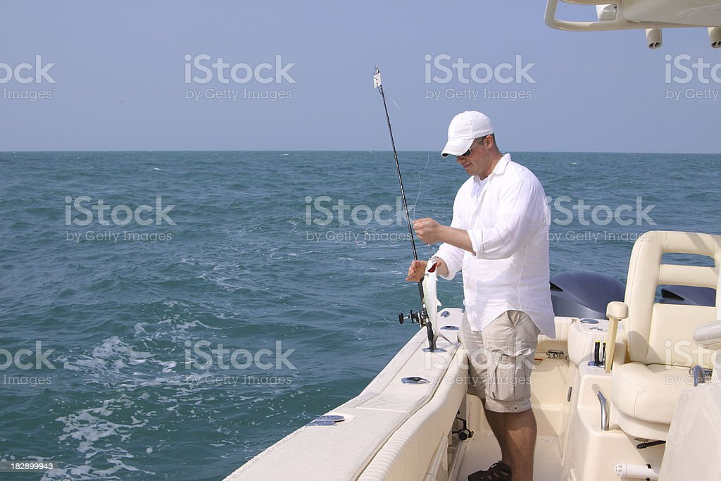 Man fishing on the Ocean royalty-free stock photo